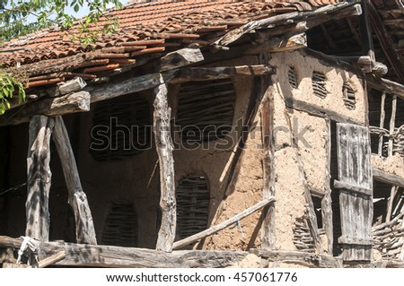 Old rural farm village barn facade with clay wall