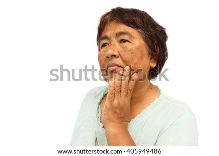 old rural woman with blemish , acne , mole and wrinkle on her face ( isolated background and blank area at left side ) ( anti-aging concept ) - stock photo