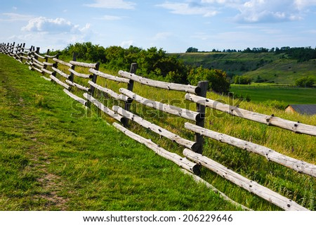 old rural wooden fence on beauty landscape view backgrounds - stock photo
