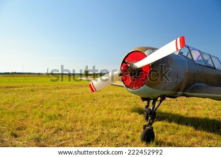 Old russian airplane on green grass - stock photo