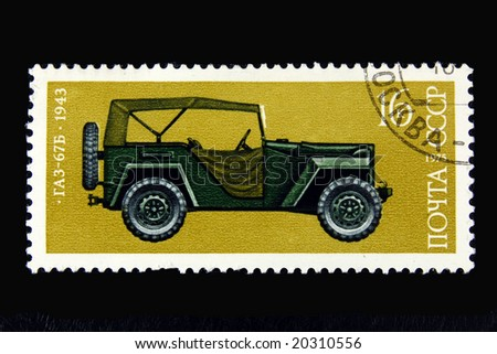 Old  Russian postage stamp with car on black background - stock photo