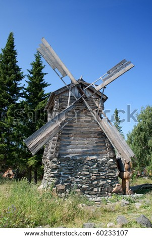 Old Russian windmill. Abandoned in wood.