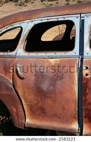 Old rusted car door - stock photo
