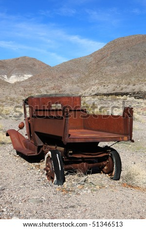 Old rusted car in junk yard . National park Death valley - stock photo