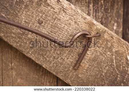 Old rusted door latch - stock photo