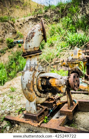 Old rusted pump - stock photo