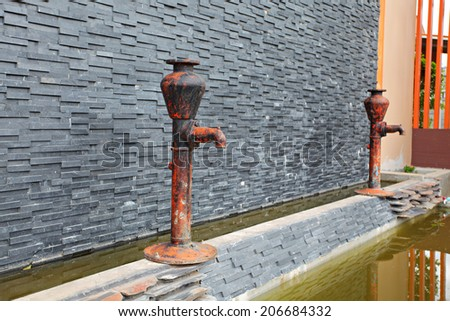 old rusted water pump - stock photo