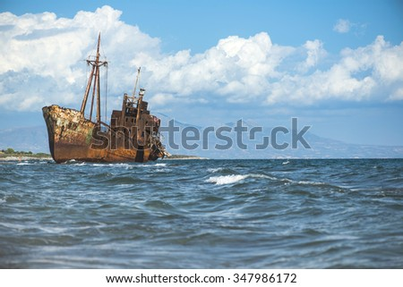 Old rustic big ship. Blue sky