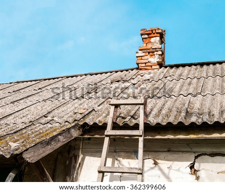Old rustic roof on the old building - stock photo