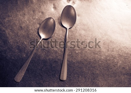 Old rustic stainless steel spoon on rustic steel background, Vintage tone  - stock photo