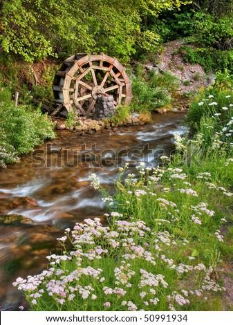 Old rustic water wheel on Mill Creek, in Millcreek Canyon, near Salt Lake City. - stock photo