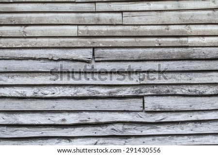 Old rustic wood background with overlapping planks - stock photo