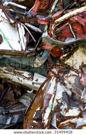 old rusting scrapped cars in a junk yard - stock photo