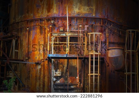 old rusty abandoned blast furnace - stock photo