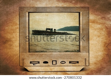 Old rusty abandoned ruined boat on TV - stock photo