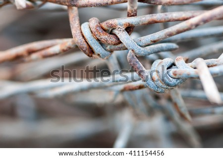 old rusty barbed wire in the country - stock photo