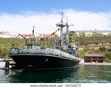 old rusty barge moored in the port dock - stock photo