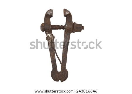 Old rusty bench vice, metal vice with a screw on a white background - stock photo