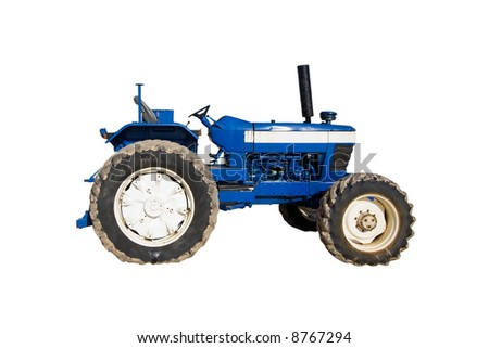 old rusty blue tractor with dirty wheels - stock photo