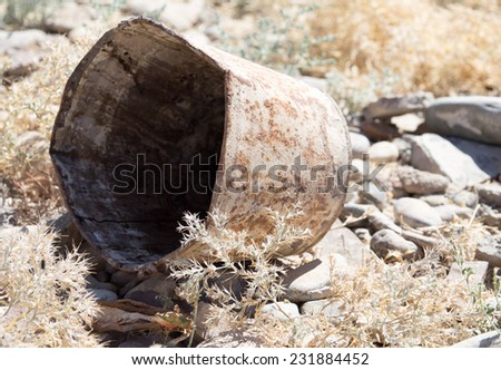 old rusty bucket - stock photo