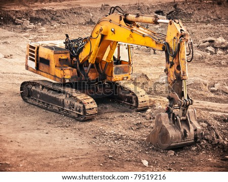 old rusty bulldozer machine on a break - stock photo
