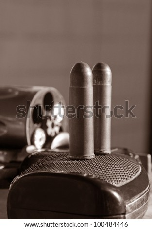 old rusty bullets on the revolver - stock photo