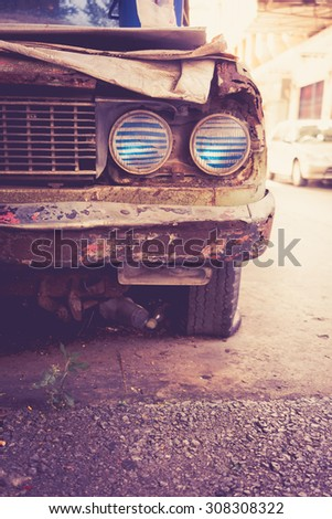 Old rusty car headlight vintage color - stock photo
