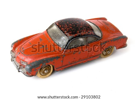 Old rusty car toy - stock photo