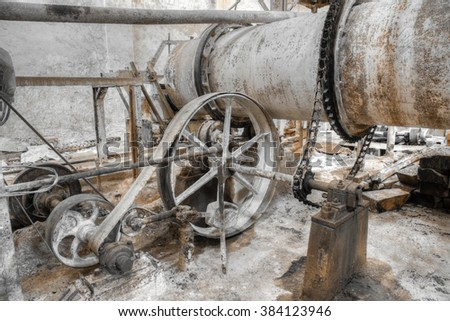 Old rusty colonial style factory for grinding limestone