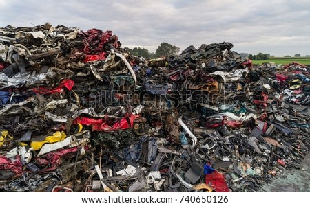 Old rusty corroded car parts in car scrapyard. Car recycling