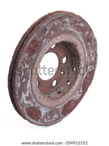 Old rusty disk brakes on white background - stock photo