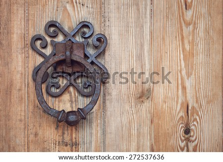 old rusty doorknob and wood door.  Background for design