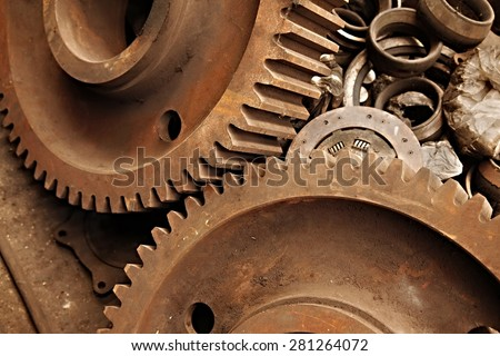 Old rusty gears of a steel machinery - stock photo