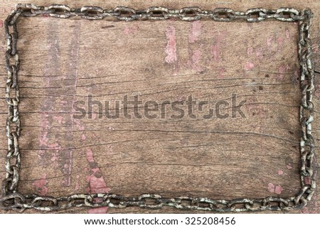 Old rusty grunge chain on vintage grunge wooden background in vintage style - stock photo