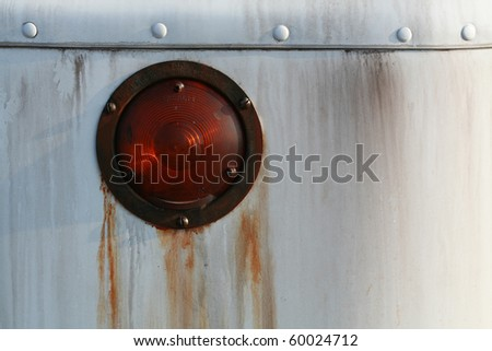 Old rusty headlamp or lights from a beat up car - stock photo