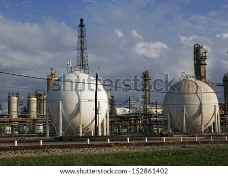 Old rusty industrial chemical tanks at a power plant