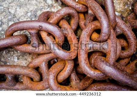 old rusty iron chains, knotted and worn from use - stock photo