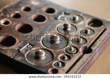 Old rusty iron scale weight. - stock photo