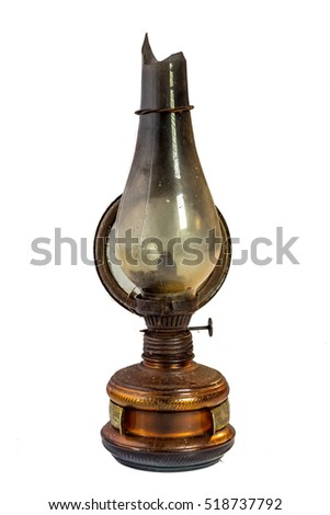 Old rusty kerosene lamp isolated on white