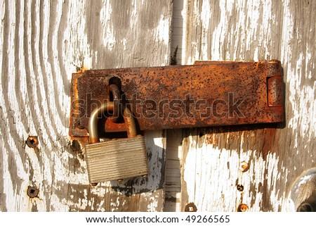 Old rusty lock - stock photo