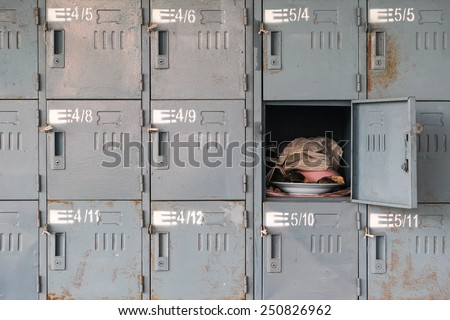 Old rusty lockers with one opened - stock photo