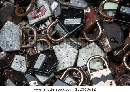 Old rusty locks and keys at flea market in Paris. Selective focus and shallow depth of field. - stock photo