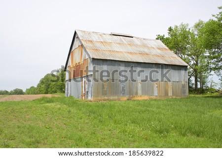 Old rusty metal barn.  - stock photo