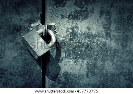 Old rusty metal door with lock - stock photo