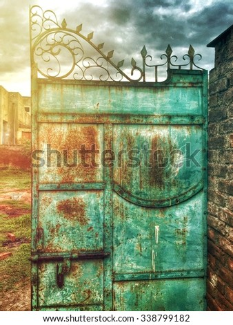 Old rusty metal gate in Kharian village Pakistan - stock photo