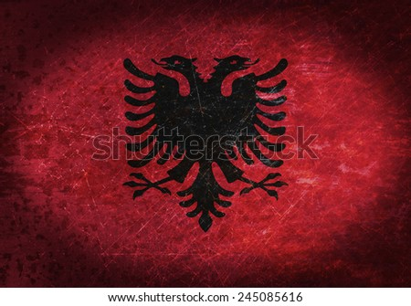 Old rusty metal sign with a flag - Albania
