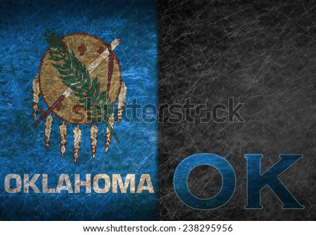 Old rusty metal sign with a flag and US state abbreviation - Oklahoma - stock photo