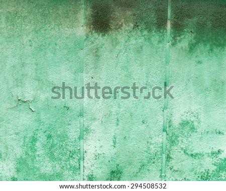 Old rusty metal wall green texture - stock photo