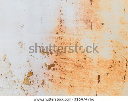old rusty metallic surface painted wall with peeling paint chipping - stock photo