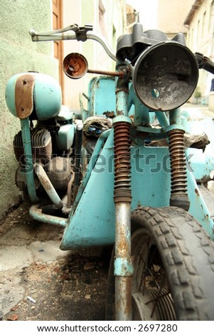 Old rusty motorcycle - stock photo